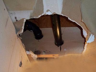 holes in floor joist structura